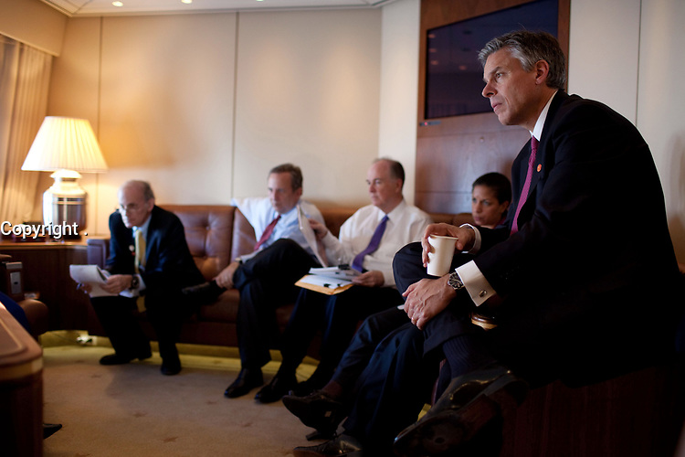 U.S. Ambassador to China Jon Huntsman, right, listens as President Barack Obama meets with advisors on Air Force Once. Pictured from left: NSC Senior Director for Asian Affairs Ambassador Jeff Bader, National Economic Council Director Larry Summers, Deputy National Security Advisor Tom Donilon and U.S. Permanent Representative to the United Nations Susan E. Rice, en route to Beijing, China, Nov. 16, 2009. (Official White House Photo by Pete Souza)<br /> <br /> This official White House photograph is being made available only for publication by news organizations and/or for personal use printing by the subject(s) of the photograph. The photograph may not be manipulated in any way and may not be used in commercial or political materials, advertisements, emails, products, promotions that in any way suggests approval or endorsement of the President, the First Family, or the White House.