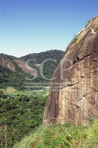Ilha Grande, Brazil. Mata Atlantica rainforest - partly deforested area of hills.