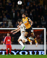 Jordi Amat of Swansea City and Ahmed Elmohamady of Hull City during the Capital One Cup match between Hull City and Swansea City played at the Kingston Communications Stadium, Hull