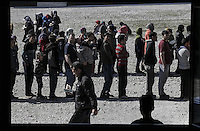 Pictured: Queues of refugees waiting for food Friday 26 February 2016<br />Re: Hundreds of refugees have been given temporary shelter at the Stefanakis Army Camp in the Schisto area of Athens, Greece.