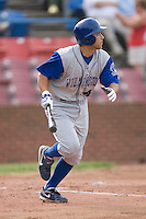 Anthony Seratelli #44 of the Wilmington Blue Rocks watches the flight of the baseball as he starts down the first base line at Wake Forest Baseball Stadium June 14, 2009 in Winston-Salem, North Carolina. (Photo by Brian Westerholt / Four Seam Images)