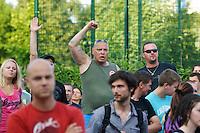 """Auf einer Buergerversammlung mit ca. 500 Teilnehmern im Berliner Plattenbaubezirk Hellersdorf entlud sich am Dienstag den 9. Juli 2013 der blanker Rassismus gegen eine geplante Unterkunft fuer syrische Buergerkriegsfluechlinge. Etwa 2/3 Anwesende aeusserten, es solle """"zuerst was fuer Deutsche getan werden"""", """"das Heim anzuenden"""", """"Wer sein Heimatland verlaesst ist ein Verraeter"""", """"Wer denkt an unsere Kinder"""" und aehnliche Parolen gegen das Fluechtlingsheim. Veranstaltungsteilnehmer, die Verstaendnis fuer die Buergerkriegsfluechtlinge aeusserten, wurden niedergebruellt.<br />Im Bild: Veranstaltungsteilnehmer skandieren rassistische Parolen. Einer hat dabei den rechten Arm zum Gruss erhoben.<br />9.7.2013, Berlin<br />Copyright: Christian-Ditsch.de<br />[Inhaltsveraendernde Manipulation des Fotos nur nach ausdruecklicher Genehmigung des Fotografen. Vereinbarungen ueber Abtretung von Persoenlichkeitsrechten/Model Release der abgebildeten Person/Personen liegen nicht vor. NO MODEL RELEASE! Don't publish without copyright Christian-Ditsch.de, Veroeffentlichung nur mit Fotografennennung, sowie gegen Honorar, MwSt. und Beleg. Konto:, I N G - D i B a, IBAN DE58500105175400192269, BIC INGDDEFFXXX, Kontakt: post@christian-ditsch.de<br />Urhebervermerk wird gemaess Paragraph 13 UHG verlangt.]"""