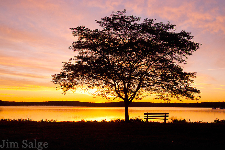 A colorful sunrise on a surprisingly crisp August morning at the park along Lake Massabesic in the Merrimack Valley of New Hampshire.