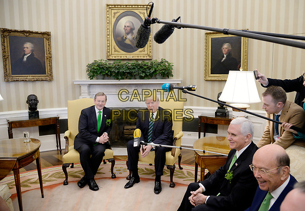 United States President Donald J. Trump holds a bilateral meeting with the Taoiseach of Ireland Enda Kenny as Vice President Mike Pence looks on in the Oval Office of the White House on March 16, 2017 in Washington, DC.<br /> CAP/MPI/CNP/RS<br /> ©RS/CNP/MPI/Capital Pictures