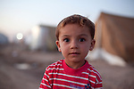 DOMIZ, IRAQ: A child in the Domiz refugee camp..Over 7,000 Syrian Kurds have fled the violence in Syria and are living in the Domiz refugee camp in the semi-autonomous region of Iraqi Kurdistan...Photo by Ali Arkady/Metrography