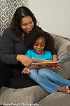 5 year old girl with stepmother reading book together