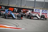 26th September 2021; Sochi, Russia; F1 Grand Prix of Russia, Race Day:  31 OCON Esteban fra, Alpine F1 A521  with 07 RAIKKONEN Kimi fin, Alfa Romeo Racing ORLEN C41