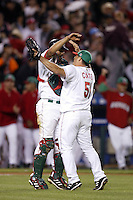 Miguel Ojeda and David Cortes of Mexico during the World Baseball Championships at Angel Stadium in Anaheim,California on March 16, 2006. Photo by Larry Goren/Four Seam Images
