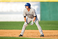 David Dahl (21) of the Asheville Tourists takes his lead off of first base against the Hickory Crawdads at L.P. Frans Stadium on April 13, 2014 in Hickory, North Carolina.  The Tourists defeated the Crawdads 5-4.  (Brian Westerholt/Four Seam Images)