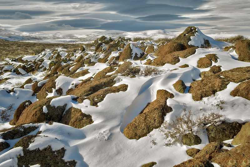 Rock outcrop and snow. Hart Mountain National Antelope Refuge, Oregon