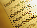 extreme tight shot of FDA nutritional content label listing saturated fat, cholesterol, sodium, total carbohydrates Note high sodium content