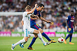 Sergio Busquets Burgos (r) of FC Barcelona battles for the ball with Toni Kroos of Real Madrid during their Supercopa de Espana Final 2nd Leg match between Real Madrid and FC Barcelona at the Estadio Santiago Bernabeu on 16 August 2017 in Madrid, Spain. Photo by Diego Gonzalez Souto / Power Sport Images