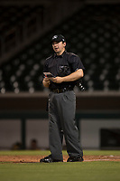 Home plate umpire Ethan Gorsak during an Arizona League game between the AZL Athletics and the AZL Cubs 1 at Sloan Park on June 28, 2018 in Mesa, Arizona. The AZL Athletics defeated the AZL Cubs 1 5-4. (Zachary Lucy/Four Seam Images)