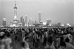 The Peoples Republic of China. Shanghai. 2000.  As dusk falls over Shanghai, tourists, primarily Chinese, gather on the Bund to look across the Huangpu river towards the lights of Pudong.  The Bund fronted the International Settlement in Shanghai, founded in 1843, while the French Concession lay to the south, adjoining the Chinese city, and spreading out to the west.  The whole area is known as Puxi, as distinct from Pudong across the river...