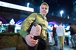 """© Joel Goodman - 07973 332324 . 16/12/2017. Manchester, UK. A man with a """" fun knee """" tattoo at Deansgate Locks . Revellers out in Manchester City Centre overnight during """" Mad Friday """" , named for historically being one of the busiest nights of the year for the emergency services in the UK . Photo credit : Joel Goodman"""