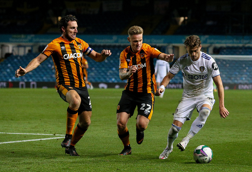 Leeds United's EzgjanAlioski shields the ball from Hull City's Thomas Mayer and Lewie Coyle<br /> <br /> Photographer Alex Dodd/CameraSport<br /> <br /> Carabao Cup Second Round Northern Section - Leeds United v Hull City -  Wednesday 16th September 2020 - Elland Road - Leeds<br />  <br /> World Copyright © 2020 CameraSport. All rights reserved. 43 Linden Ave. Countesthorpe. Leicester. England. LE8 5PG - Tel: +44 (0) 116 277 4147 - admin@camerasport.com - www.camerasport.com