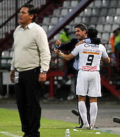 MANIZALES -COLOMBIA- 04 -12 -2013. Sergio Herrera del Once Caldas celebra su gol contra el Deportivo Pasto.Accion de juego entre los equipos Once Caldas contra Deportivo Pasto , encuentro de los cuadrangulares finales de la Liga Postobon jugado en el estadio Palogrande  / Sergio Herrera of  Once Caldas celebrates his goal against Deportivo Pasto.Accion game between teams Once Caldas vs Deportivo Pasto, meeting the end-runs Postobon League played in the stadium Palogrande.Photo: VizzorImage / Santiago Osorio / Stringer