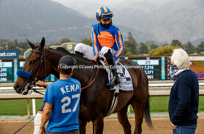 ARCADIA, CA  APRIL 24:  #2 As Time Goes By, ridden by Mike Smith, returns to trainer Bob Baffert after winning the Santa Margarita Stakes (Grade ll) on April 24, 2021 at Santa Anita Park in Arcadia, CA. (Photo by Casey Phillips/ Eclipse Sportswire/ CSM)