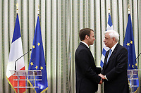 Pictured: (L-R) French President Emmanuel Macron is greeted by Greek President Prokopis Pavlopoulos. Thurday 07 September 2017<br /> Re: French President Emmanuel Macron gives a press conference alongside Greek President Prokopis Pavopoulos at the Presidential Mansion during his state visit to Athens, Greece.