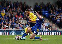 4th September 2021; Merton, London, England;  EFL Championship football, AFC Wimbledon versus Oxford City: Ben Heneghan of AFC Wimbledon challenges Nathan Holland of Oxford United in the penalty box