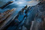 Textured rock at the edge of a stream, Jasper National Park, Alberta, Canada
