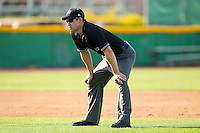 Base umpire Dan Merzel during the South Atlantic League game between the Charleston RiverDogs and the Hickory Crawdads at L.P. Frans Stadium on April 29, 2012 in Hickory, North Carolina.  The Crawdads defeated the RiverDogs 12-3.  (Brian Westerholt/Four Seam Images)