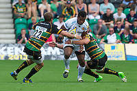 Sereli Naqelevuki of Exeter Chiefs is tackled by Stephen Myler (left) and Phil Dowson of Northampton Saints during the Aviva Premiership match between Northampton Saints and Exeter Chiefs at Franklin's Gardens on Sunday 9th September 2012 (Photo by Rob Munro)