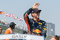 March 17, 2019: Pierre Gasly (FRA) #10 from the Aston Martin Red Bull Racing team waves to the crowd during the drivers parade prior to the start of the 2019 Australian Formula One Grand Prix at Albert Park, Melbourne, Australia. Photo Sydney Low