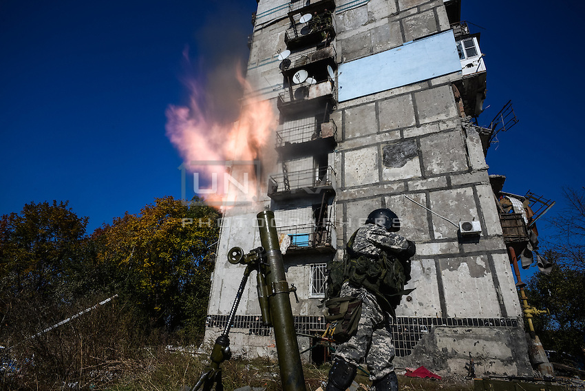 Pro-Russian rebel shoots mortars against Ukrainian army positions in Donetsk