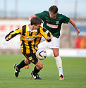Hibs' Scott Allan is challenged by East Fife's Lewis Barr.
