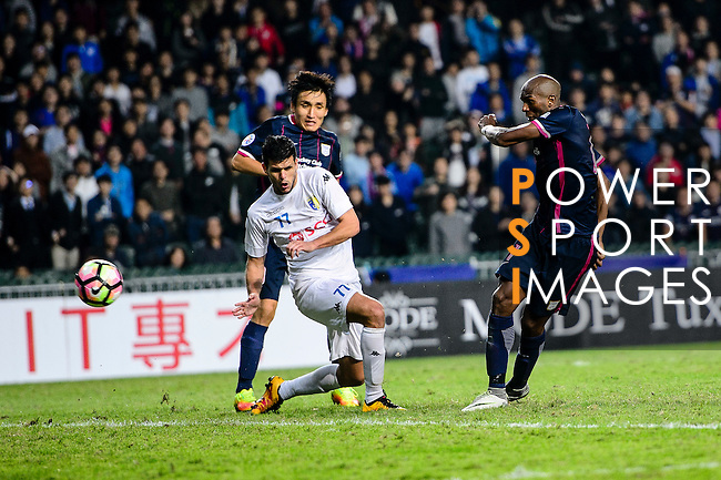 FC Kitchee Forward Alessandro Ferreira (r) attempts a kick to the goal during the AFC Champions League 2017 Preliminary Stage match between  Kitchee SC (HKG) vs Hanoi FC (VIE) at the Hong Kong Stadium on 25 January 2017 in Hong Kong, Hong Kong. Photo by Marcio Rodrigo Machado/Power Sport Images