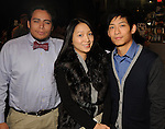 """From left:  Gus Vasquez, Yina Huang and Edward Huynh at the opening reception: """"The Wartime Escape:  Margret and H.A. Rey's Journey from France"""" at the Holocaust Museum Houston Thursday Nov. 07,2013.  (Dave Rossman photo)"""
