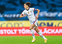SOLNA, SWEDEN - APRIL 10: Carli Lloyd #10 of the USWNT sprints during a game between Sweden and USWNT at Friends Arena on April 10, 2021 in Solna, Sweden.