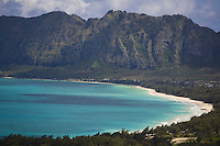White sand beach at Waimanalo Bay with Koolau mountains in the background