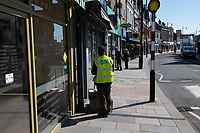A delivery driver in Sidcup, Kent during the Coronavirus (COVID-19) outbreak where travel has been restricted across the country at Sidcup, England on 25 March 2020. Photo by Alan Stanford/PRiME Media Images