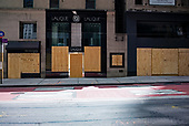 New York New York<br /> June 7, 2020<br /> <br /> After several nights of looting, nearly all ground level windows on the upper Eastside of Manhattan are covered with plywood. Many of the shops had already been looted others are boarded for protection.
