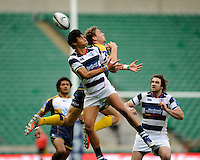 Melani Vai of Auckland and Etienne Oosthuizen of the Brumbies jump for a high ball during the World Club 7s at Twickenham on Sunday 18th August 2013 (Photo by Rob Munro)