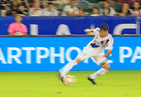 CARSON, CA - SEPTEMBER 21: Joe Corona #14 of the Los Angeles Galaxy turning with the ball during a game between Montreal Impact and Los Angeles Galaxy at Dignity Health Sports Park on September 21, 2019 in Carson, California.