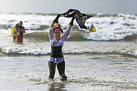 Pictured: A woman flies a pirate flag.  Tuesday 26 December 2017<br /> Re: Hundreds took part in this year's Boxing Day Walrus Dip which see people in fancy dress taking to the sea at Cefn Sidan beach in Pembrey Country Park, west Wales, UK.