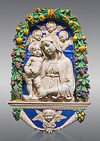 Enamelled terracotta relief panel of the Virgin and Child with Cherubs by Andrea  della Robbia, Florence circa 1435-1525.  Inv  Campana 32,  The Louvre Museum, Paris.