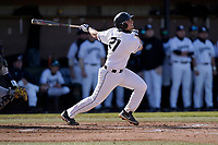Jack Gallagher (21) of the University of South Carolina Upstate Spartans bats in a game against the University of Toledo Rockets on Friday, February 19, 2021, at Cleveland S. Harley Park in Spartanburg, South Carolina. Upstate won, 14-2. (Tom Priddy/Four Seam Images)
