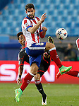 Atletico de Madrid's Raul Garcia (f) and Bayer 04 Leverkusen's Wendell during Champions League 2014/2015 match.March 16,2015. (ALTERPHOTOS/Acero)