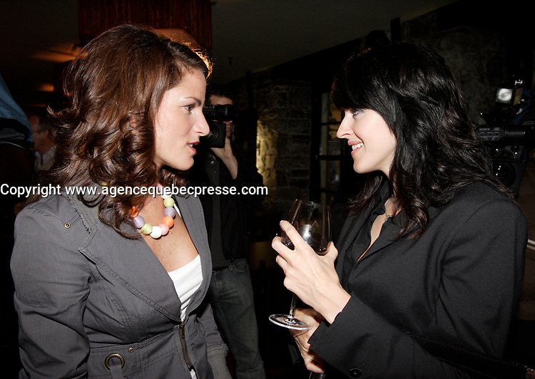 Marcoux (L) Genevieve Borne (R)  Sophie Chiasson book launch, 2006-09-21.<br /> <br /> she is a weather presentator on TVA who won a diffamtion lawsuit against Quebec City Genex radio host Jeff Fillion<br /> Photo by P. Roussel / Images Distribution
