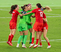 YOKOHAMA, JAPAN - AUGUST 6: Stephanie Labbe #1 of Canada celebrates with Christine Sinclair #12 during a game between Canada and Sweden at International Stadium Yokohama on August 6, 2021 in Yokohama, Japan.