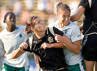 Christine Sinclair (left) and Niki Cross (right) struggle for position on a corner kick. FC Gold Pride tied the St. Louis Athletica 1-1 at Buck Shaw Stadium in Santa Clara, California on August 9, 2009.
