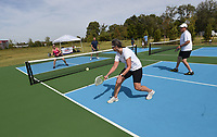 """DAY AT OSAGE<br />Adrenne (cq) Conklin (from left), Kip Lacey, Kathryn Hotchkiss (cq) and Jeff Hedges, all ambassadors or referees with USA Pickleball Association, play the game on Saturday Oct. 9 2021 during """"A Day at Osage Park. They were on hand at the celebration to give pointers to players and promote the fast-growing sport. """"A Day at Osage Park"""" showcased a variety of activities available at the park including pickleball, archery, food, and strolling on a boardwalk above ta wetland. Conservation groups and vendors had exhibits. Go to nwaonline.com/211010Daily/ to see more photos. <br />(NWA Democrat-Gazette)"""