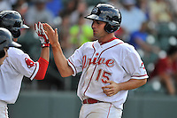 Designated hitter Tyler Spoon (15) of the Greenville Drive is congratulated after scoring a run in a game against the Lakewood BlueClaws on Sunday, June 26, 2016, at Fluor Field at the West End in Greenville, South Carolina. Greenville won, 2-1. (Tom Priddy/Four Seam Images)
