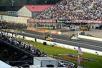 Sep 5, 2016; Clermont, IN, USA; NHRA top fuel driver J.R. Todd (left) races alongside Morgan Lucas during the US Nationals at Lucas Oil Raceway. Mandatory Credit: Mark J. Rebilas-USA TODAY Sports