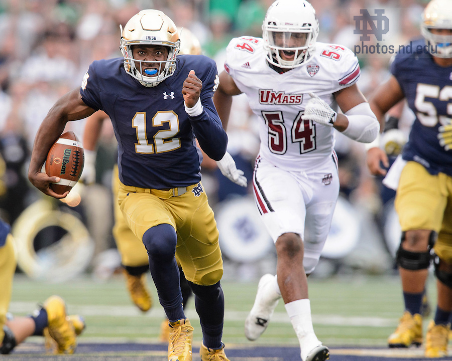 Sep 26, 2015; Irish quarterback Brandon Wimbush (12) runs for a touchdown in the third quarter against UMass. Notre Dame won 62-27. (Photo by Matt Cashore)