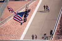 Nov 3, 2019; Las Vegas, NV, USA; A sky diver parachutes in with the American flag prior to the NHRA Dodge Nationals at The Strip at Las Vegas Motor Speedway. Mandatory Credit: Mark J. Rebilas-USA TODAY Sports